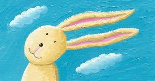 在风的逗人喜爱的兔子 免版税库存照片