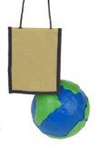 旅行袋子和地球 库存照片