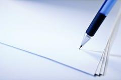 Ручка на бумаге Стоковое фото RF