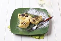 与罂粟的种子和糖的土豆汤 免版税图库摄影