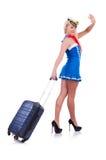 妇女带着手提箱的旅行乘务员 免版税库存照片