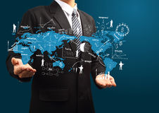 План глобального бизнеса в руке бизнесмена Стоковое Изображение RF