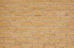 新的米黄砂岩墙壁 免版税库存图片