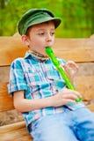 Молодой мальчик играя рекордера Стоковые Фото