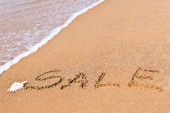 在沙子画的书面销售 免版税库存照片