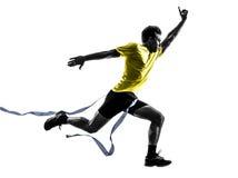 年轻人短跑选手赛跑者连续优胜者终点线剪影 库存图片