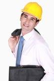 有公文包的一位建筑师。 免版税库存图片