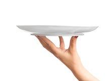 Κενό εξυπηρετώντας χέρι πιάτων Στοκ εικόνα με δικαίωμα ελεύθερης χρήσης