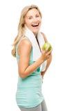 在白色后面隔绝的健康成熟妇女锻炼绿色苹果 免版税库存图片