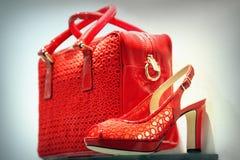 Красные ботинок и сумка Стоковые Фотографии RF
