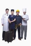 医生、空气空中小姐、建筑工人和厨师演播室射击画象  库存照片