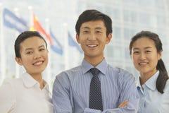 三个年轻商人,北京画象  免版税库存图片