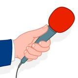 Άτομο που αντέχει ένα μικρόφωνο Στοκ φωτογραφία με δικαίωμα ελεύθερης χρήσης