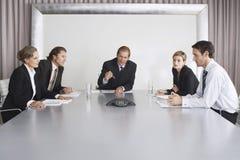电话会议的商人 免版税库存图片
