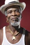 老人佩带的浅顶软呢帽和大奖章 图库摄影