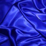 背景的蓝色织品缎纹理。传染媒介 库存照片