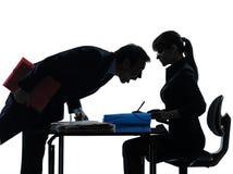女商人人夫妇剪影 免版税图库摄影