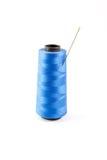 蓝色螺纹和针 库存图片