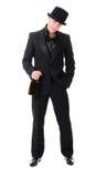 Αναδρομικό μοντέρνο άτομο στο μαύρο κοστούμι με το μπουκάλι του ποτού Στοκ Εικόνες