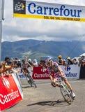 圆点泽西骑自行车者皮埃尔罗兰特 库存照片
