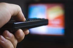 控制远程电视注意 免版税库存图片