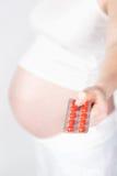 有片剂的孕妇 库存照片
