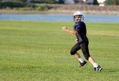 青年橄榄球接收器 图库摄影