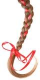 妇女编辫子用在白色隔绝的一把红色弓装饰。 免版税库存图片