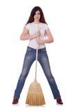 Νέα γυναίκα με τη σκούπα Στοκ Εικόνα