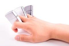 Αναπτήρες μετάλλων εκμετάλλευσης χεριών που απομονώνονται στο λευκό Στοκ φωτογραφία με δικαίωμα ελεύθερης χρήσης