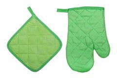 烤箱手套和握持热锅的布垫子 免版税库存照片