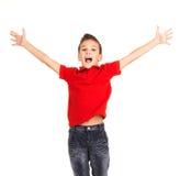 跳跃用被举的手的愉快的男孩 免版税库存照片