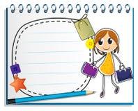 Ένα σημειωματάριο με ένα σχέδιο των τσαντών μιας κοριτσιών εκμετάλλευσης Στοκ Φωτογραφίες