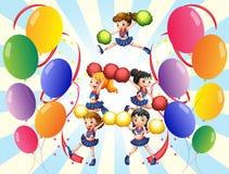 在气球中间的一个欢呼的小队 免版税库存照片