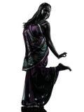 印地安妇女舞蹈家跳舞剪影 图库摄影