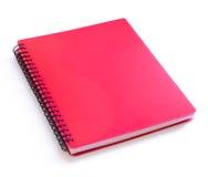 在白色背景隔绝的红色螺纹笔记本 免版税库存图片