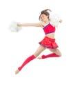 从啦啦队欢呼队跳跃的啦啦队员舞蹈家 库存照片