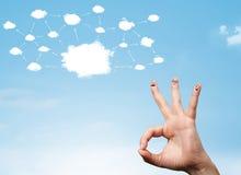 与云彩网络系统的手指面带笑容 库存照片