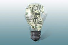 Электрическая лампочка с долларами Стоковое Изображение