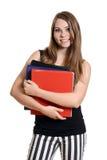 有教科书的青少年的女孩 免版税图库摄影