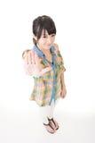 打手势停车牌的一名亚裔妇女的画象 库存照片
