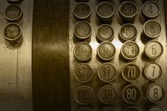 单色古色古香的收款机按钮 免版税库存图片