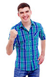 有被举的拳头的快乐的人 免版税库存照片