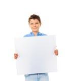 有标志的男孩 免版税库存图片