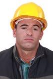 Ένας τρυπημένος εργάτης οικοδομών. Στοκ Φωτογραφίες
