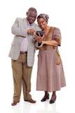 老非洲夫妇片剂 库存图片