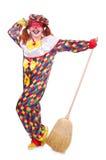 有笤帚的小丑 免版税库存图片