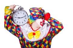 有闹钟的小丑 库存图片