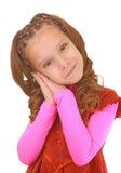 桃红色礼服的微笑的女小学生 免版税库存图片
