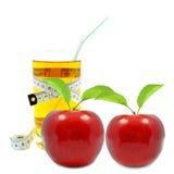 Яблочный сок и метр Стоковое Фото